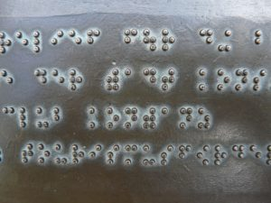 braille on an metal or brass plate